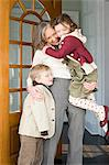 Grandmother hugging grandchildren Stock Photo - Premium Royalty-Freenull, Code: 6114-06606668