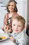 Boy and grandmother having meal Stock Photo - Premium Royalty-Free, Artist: CulturaRM, Code: 6114-06606671