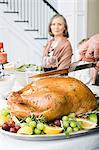 Person carving turkey Stock Photo - Premium Royalty-Free, Artist: Angus Fergusson, Code: 6114-06606680