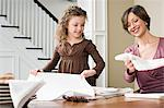 Mother and daughter folding napkins Stock Photo - Premium Royalty-Freenull, Code: 6114-06606681