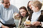 Grandparents and grandchildren eating pie Stock Photo - Premium Royalty-Free, Artist: Cultura RM, Code: 6114-06606685