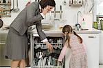 Daughter helping mother with filling dishwasher Stock Photo - Premium Royalty-Free, Artist: Cultura RM, Code: 6114-06606742