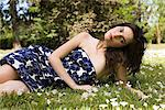 Young woman lying on grass Stock Photo - Premium Royalty-Free, Artist: ableimages, Code: 6114-06606784
