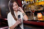 Young woman in a bar Stock Photo - Premium Royalty-Free, Artist: Ascent Xmedia, Code: 6114-06606786