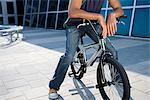 A teenage sat on a bmx Stock Photo - Premium Royalty-Free, Artist: ableimages, Code: 6114-06606796