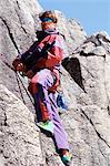 A climber abseiling down a rock Stock Photo - Premium Royalty-Free, Artist: ableimages, Code: 6114-06606842