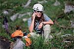 Hiker on cellphone Stock Photo - Premium Royalty-Free, Artist: AWL Images, Code: 6114-06606862