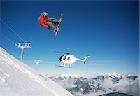 Snowboarder and helicopter Stock Photo - Premium Royalty-Freenull, Code: 6114-06607192
