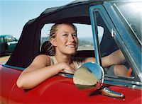 Young woman in a red car Stock Photo - Premium Royalty-Freenull