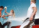 Young people washing car and having water fight Stock Photo - Premium Royalty-Free, Artist: Aflo Sport, Code: 6114-06607436