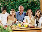 Family dining al fresco Stock Photo - Premium Royalty-Free, Artist: Michael Mahovlich, Code: 6114-06607462