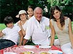 Children having a picnic with their grandparents Stock Photo - Premium Royalty-Free, Artist: Blend Images, Code: 6114-06607485