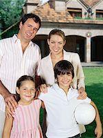 Family in the garden Stock Photo - Premium Royalty-Freenull, Code: 6114-06607502