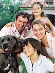 Family and dog in the garden Stock Photo - Premium Royalty-Free, Artist: Blend Images, Code: 6114-06607509
