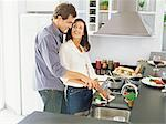 Couple preparing ingredients for a meal Stock Photo - Premium Royalty-Free, Artist: Photocuisine, Code: 6114-06607529