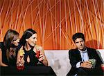 Women checking out an attractive man in a bar Stock Photo - Premium Royalty-Free, Artist: Blend Images, Code: 6114-06607560