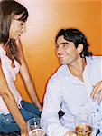 Man flirting with woman Stock Photo - Premium Royalty-Free, Artist: Blend Images, Code: 6114-06607591