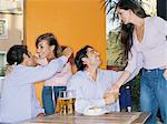 Friends greeting each other in a bar Stock Photo - Premium Royalty-Free, Artist: Cultura RM, Code: 6114-06607602