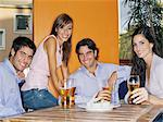Friends having a beer Stock Photo - Premium Royalty-Free, Artist: Cultura RM, Code: 6114-06607606