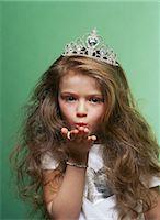 preteen kissing - Princess blowing a kiss Stock Photo - Premium Royalty-Freenull, Code: 6114-06607644