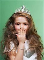 Princess covering her mouth Stock Photo - Premium Royalty-Freenull, Code: 6114-06607655