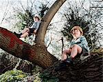 Two boys in a tree Stock Photo - Premium Royalty-Free, Artist: CulturaRM, Code: 6114-06607698