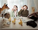 Children having a tea party with animals Stock Photo - Premium Royalty-Freenull, Code: 6114-06607701