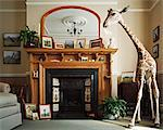 Stuffed giraffe in a living room Stock Photo - Premium Royalty-Free, Artist: Ikonica, Code: 6114-06607720