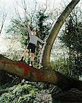 Boy standing in a tree Stock Photo - Premium Royalty-Free, Artist: CulturaRM, Code: 6114-06607723