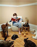 story - Boy reading story to stuffed animals Stock Photo - Premium Royalty-Freenull, Code: 6114-06607735