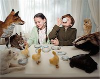 preteen girl pussy - Children having a tea party with animals Stock Photo - Premium Royalty-Freenull, Code: 6114-06607737