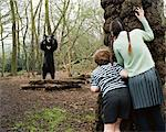 Children watching bear from behind a tree Stock Photo - Premium Royalty-Free, Artist: CulturaRM, Code: 6114-06607742