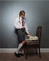 preteen girl pussy - Girl stroking stuffed cat Stock Photo - Premium Royalty-Freenull, Code: 6114-06607759