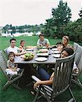 Family and friends having a meal outside Stock Photo - Premium Royalty-Free, Artist: Blend Images, Code: 6114-06607767
