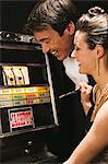 Couple playing on a fruit machine Stock Photo - Premium Royalty-Free, Artist: Robert Harding Images, Code: 6114-06607815