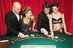 Two couples playing blackjack Stock Photo - Premium Royalty-Free, Artist: Aflo Relax, Code: 6114-06607820