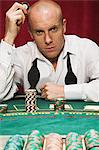 Man at blackjack table Stock Photo - Premium Royalty-Free, Artist: ableimages, Code: 6114-06607825