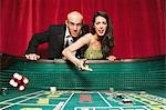 Couple playing craps Stock Photo - Premium Royalty-Free, Artist: Robert Harding Images, Code: 6114-06607828