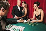 Couple watching woman play blackjack Stock Photo - Premium Royalty-Free, Artist: Blend Images, Code: 6114-06607831
