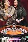 Women having fun at roulette wheel Stock Photo - Premium Royalty-Free, Artist: Blend Images, Code: 6114-06607834