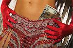 Showgirl with money in her skirt Stock Photo - Premium Royalty-Free, Artist: AWL Images, Code: 6114-06607836