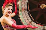 Showgirl spinning the wheel of fortune Stock Photo - Premium Royalty-Free, Artist: Robert Harding Images, Code: 6114-06607843