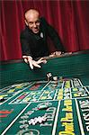Man throwing dice at craps table Stock Photo - Premium Royalty-Free, Artist: Robert Harding Images, Code: 6114-06607849