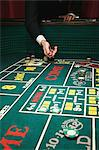Throwing dice at a craps table Stock Photo - Premium Royalty-Free, Artist: Robert Harding Images, Code: 6114-06607867