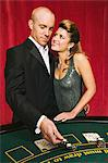 Man playing blackjack with adoring woman Stock Photo - Premium Royalty-Free, Artist: Masterfile, Code: 6114-06607868