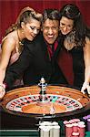 Man and two women at roulette table Stock Photo - Premium Royalty-Free, Artist: Aflo Relax, Code: 6114-06607874