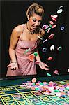 Woman throwing gambling chips Stock Photo - Premium Royalty-Free, Artist: Robert Harding Images, Code: 6114-06607875