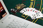 Gambling with laptop computer Stock Photo - Premium Royalty-Free, Artist: Ikon Images, Code: 6114-06607876