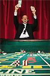 Man winning at craps Stock Photo - Premium Royalty-Free, Artist: Marc Simon, Code: 6114-06607877
