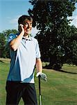 Golfer on mobile phone Stock Photo - Premium Royalty-Free, Artist: Blend Images, Code: 6114-06607884